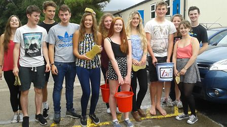 Students from Backwell School taking part in a car wash to raise money for the Za Foundation.