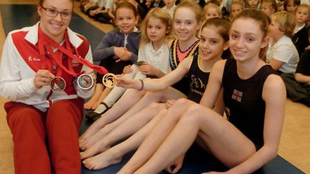 Gymnasts from Portishead academy visiting Crockerne Primary School, Pill.