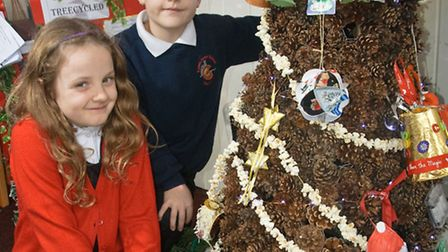 Year three pupils Sophie and Daniel with the tree.