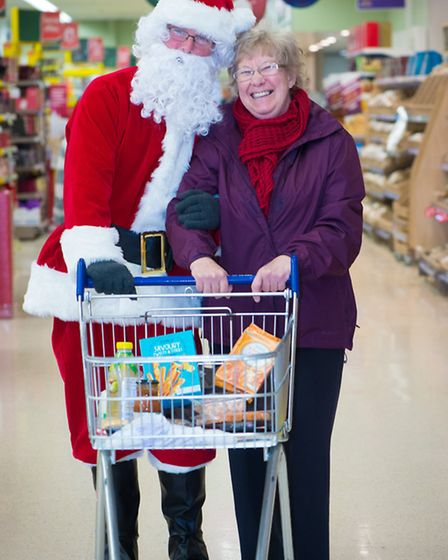 Shoppers enjoy festive cuddles with Father Christmas.