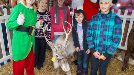 Shoppers at Tesco enjoy a visit from Santa, his elves and reindeer.