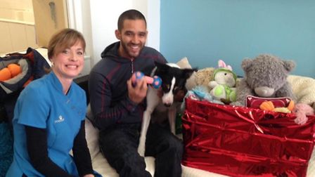 Joshua and Nero enjoying a visit to Dogs Palace with Carolyn Price.