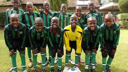 Children from Kenya wearing their kit from Backwell Junior Athletic Club.