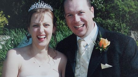 Elizabeth Linham on her wedding day with Adrian. Picture: SWNS.