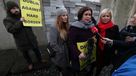 Sinn Fein leader Mary Lou McDonald (third left) and deputy leader Michelle O'Neill (right) stand in