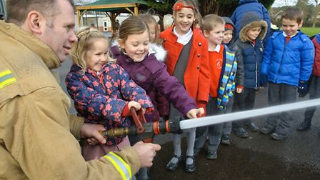 Clevedon firefighters with pupils from Yeo Moor School.