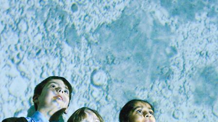 St Francis Primary School pupils looking at the suface of the moon.