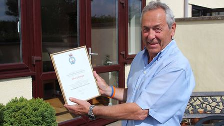 John Gittings with his letter of thanks from the RNLI for his fundraising efforts.