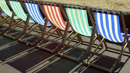 Grab a deck chair on the beach and tuck into some fish and chips. (Image by Timothy Large, Getty Ima