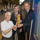 Tributes have been paid to Clive Bush (left, with a replica World Cup trophy he used to raise money)