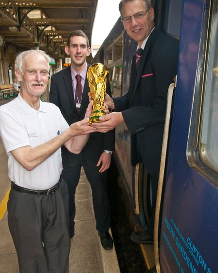 Clive Bush(left) took the replica World Cup around Weston and Highbridge.