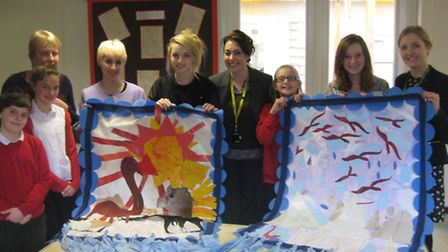 Pupils and teachers with the wall hangings