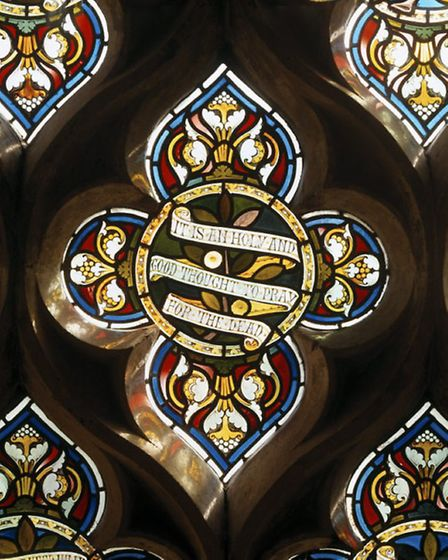 The central section of the South stained glass window in The Chapel at Clevedon Court. (©National Tr