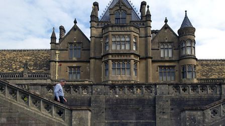 Visitors on the steps from the terrace on the south front at Tyntesfield, Somerset.© National Trust