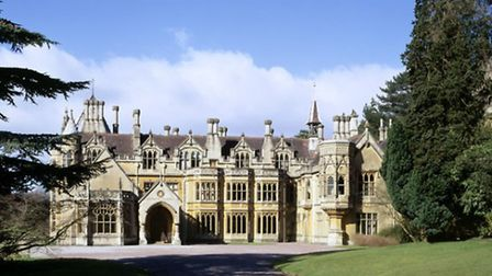 Medium view of the East Front of Tyntesfield. The Library is to the left of the porch and the first