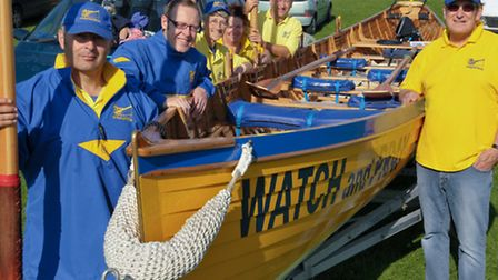 Members of Clevedon Pilots Gig Club with their boat Watch and Pray at the Clevedon Marlin Marine Lak