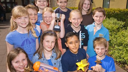 Pupils with their biscuits and their trophy.