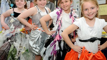 Children put their design skills to the test by making outfits from waste products.