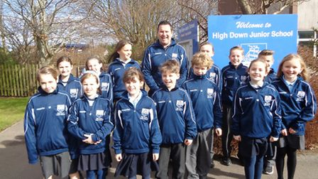 Children from High Down Junior School showing off their new sports kit.