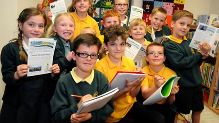 """Pupils with their school newsletter """"Trinity Times"""" at Trinity Primary School. Picture: Jeremy Long."""