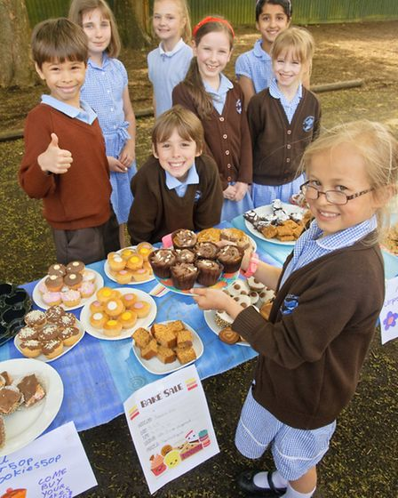 Jemima Ross (front) who organised a cake sale.