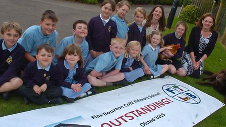 Flax Bourton Primary School celebrating receiving outstanding Ofsted report.