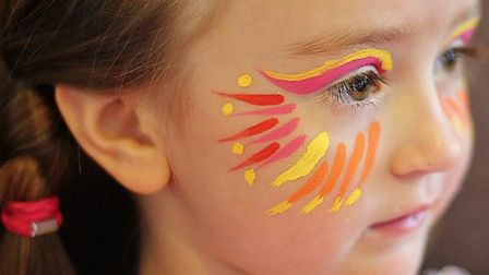 Get in the carnival spirit with face paints. (Festival Girl by Alison Benbow under CC BY 2.0)