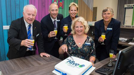 Managers at The Hive toast recent successes.