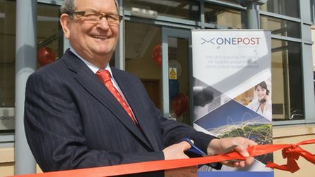 Managing Director Graham Cooper cutting the ribbon.