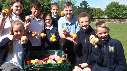 Pupils with the crate of fruit donated by Asda.