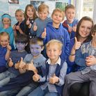 Pupils in blue with Freddie (right) who suffers from MPS and one of his support workers, Jen Tovey,