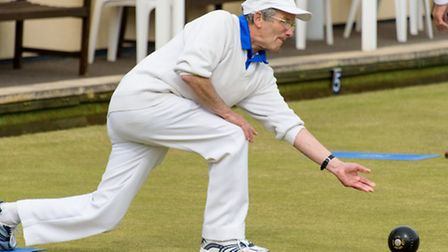 Ken Curtis bowling for St Andrews.