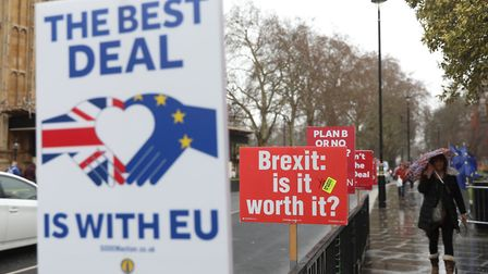 Anti-Brexit placards stand outside the Houses of Parliament as Brexit negotiations continue. Picture
