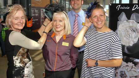 Sainsburys at Portishead Tricia Designs showing off occasion hats to shoppers.