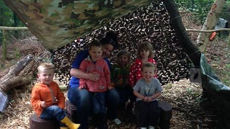 Families using the new forest skills area at Nailsea and Backwell Children's Centre.