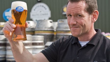 Stuart Howe with a beer