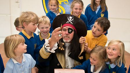Pirate Captain Cadwallader talking to pupils about his treasure.