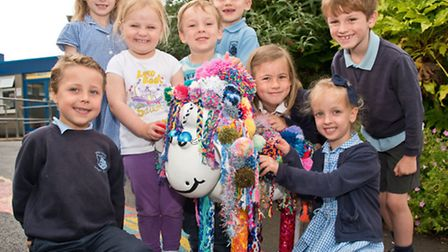 Pupils showing off their woolly Shaun the Sheep statue.