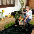 Organiser Margaret Gosling with the Harvest display. Photo by Jeremy Long.