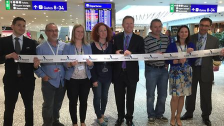 Bristol Airport's chief executive Robert Sinclair opening the eastern terminal extension with staff.