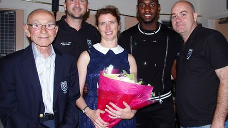 Footballer Yannick Bolasie presents Della Hudson, of Hudson Accountants, with flowers for her suppor