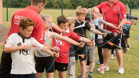 Archery coach Paul Maines with students.