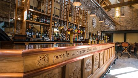 The bar at The Railway Inn has been carved by hand to reflect Somerset's heritage.