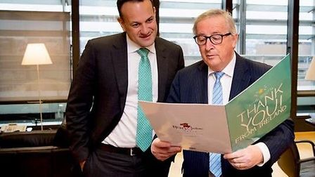 Leo Varadkar and Jean-Claude Junker with a 'Thank You' card from an Irish citizen. Photograph: Marga