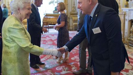 John Orkney meeting the Queen.