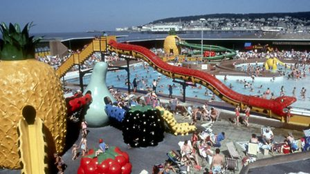 Tropicana view of pool and slides with Weston in the background.