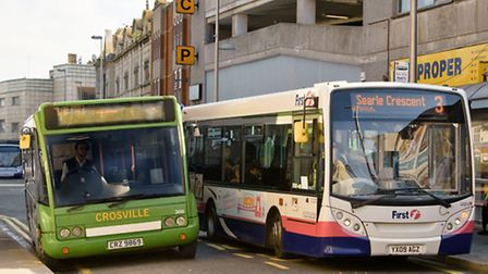 Crossville and First Bus vehicles in the town centre.