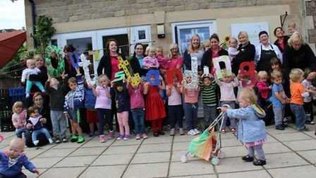Staff and children at Lakehouse Nursery.