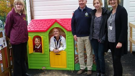 Lion President Wendy Hasler tries out the play cottage, watched by Lions member Peter Smith, and Rav