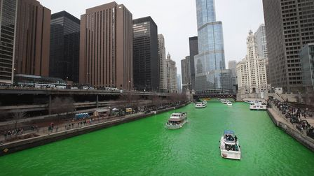 Boats navigate the Chicago River shortly after it was dyed green in celebration of St. Patrick's Day